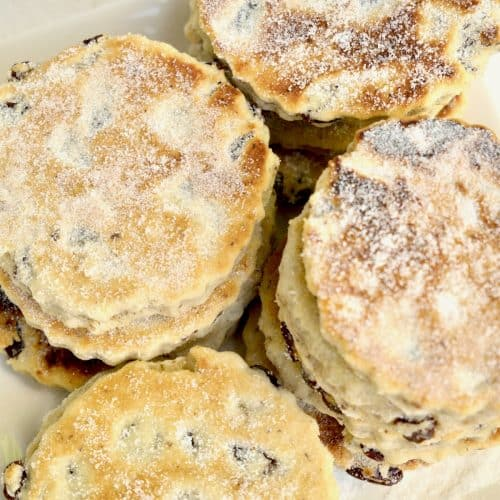 A pile of vegan welsh cakes topped with sugar