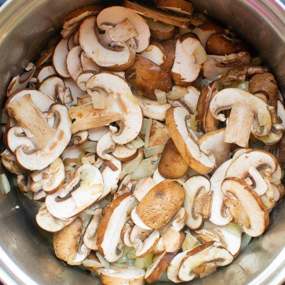 Sliced chestnut mushrooms in a pan.