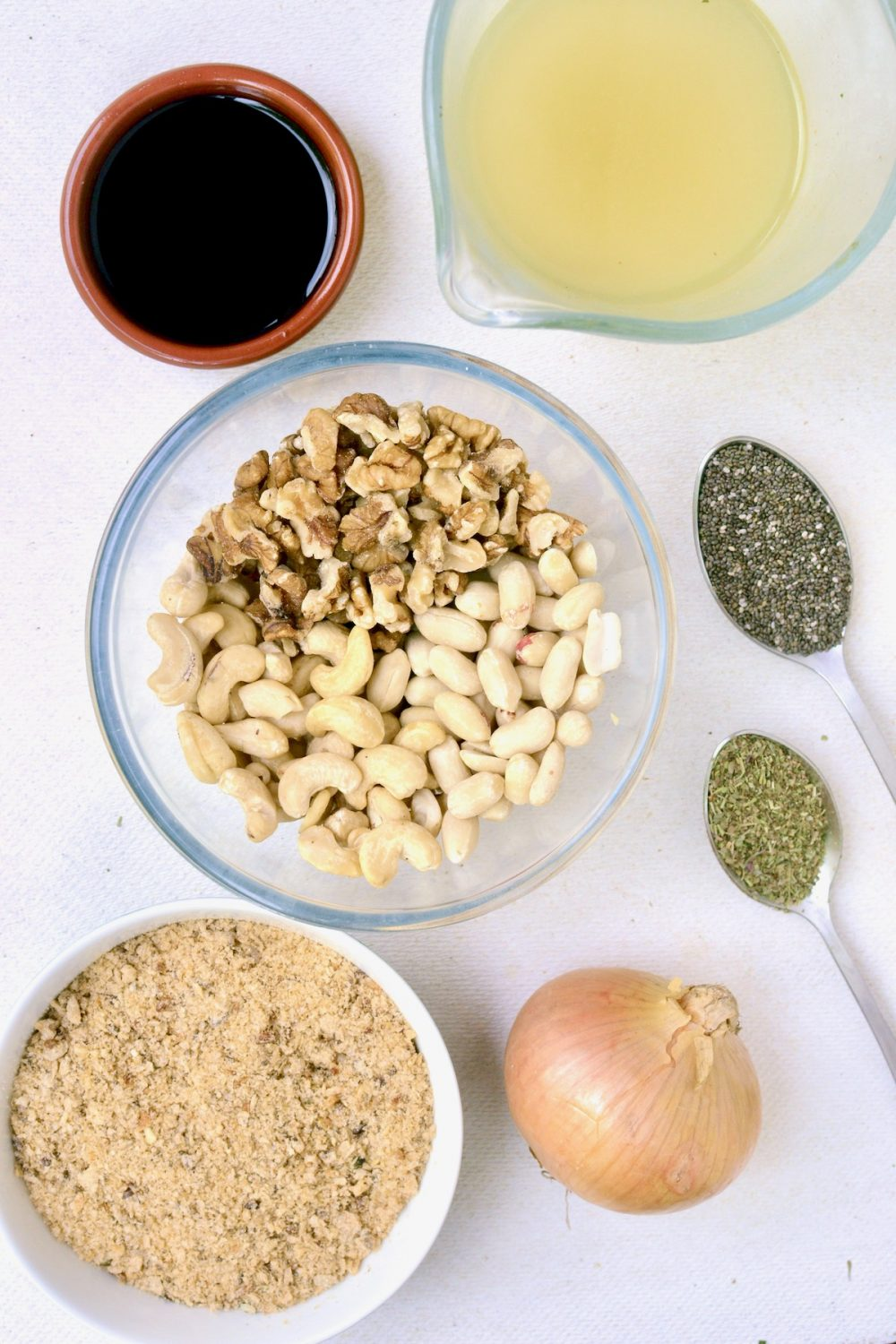 The ingredients for the vegan nut burger patties: Mixed nuts, bread crumbs, an onion, dried herbs, chia seeds, soy sauce and vegetable bouillon.
