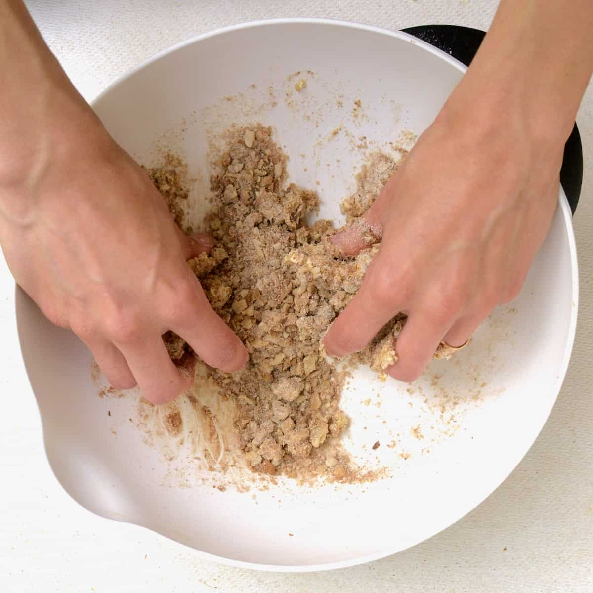 Mixing the streusel topping by hand.