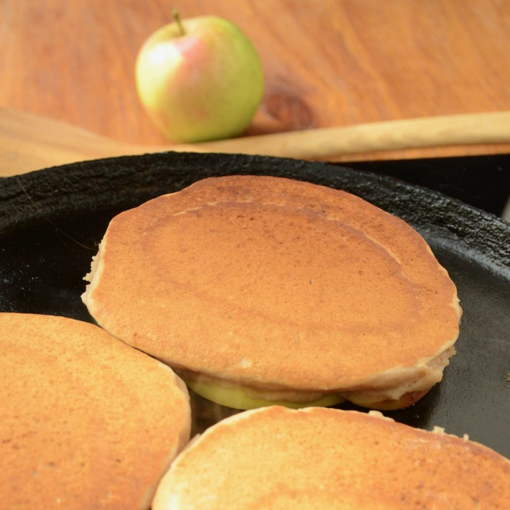The golden brown top of the flipped pancakes.