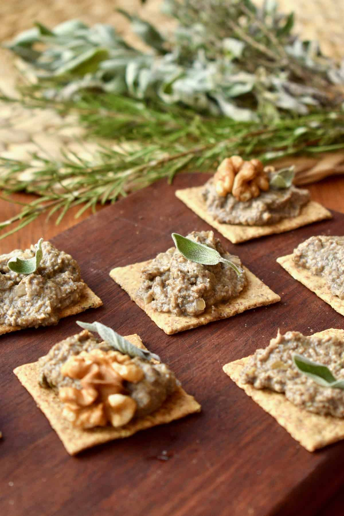 Square crackers topped with mushroom and walnut pate.