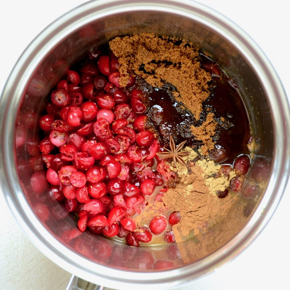 Cranberries, spices, orange juice and sugar in a saucepan.
