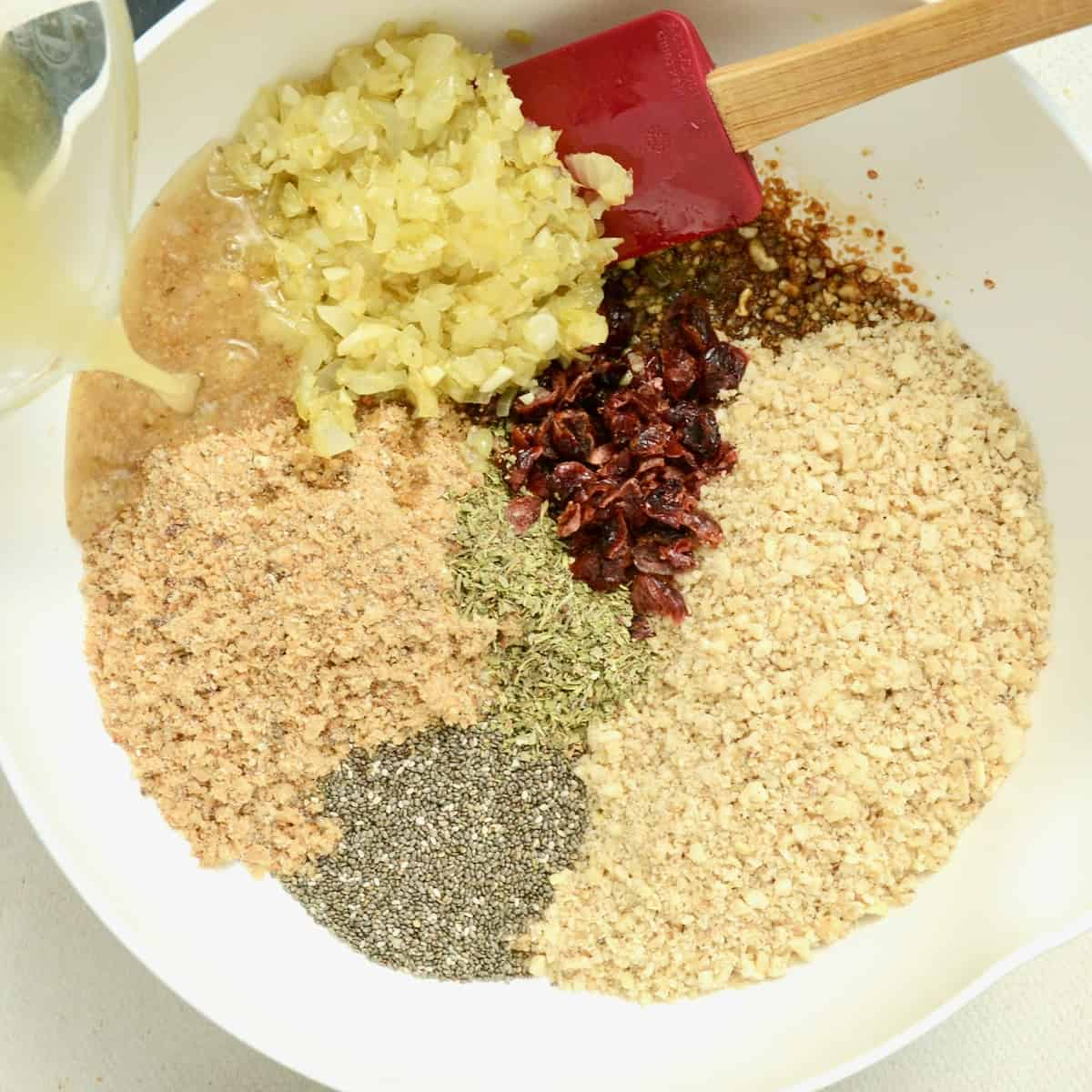 The nuts, now ground and the onions finely chopped and sauted, are combined with the other ingredients in a bowl.