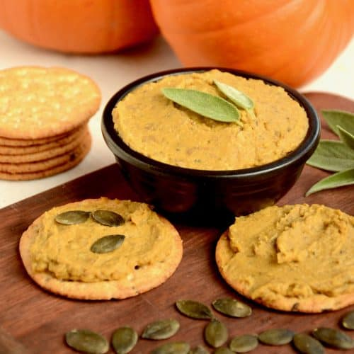 The finished pumpkin dip is garnished with sage.