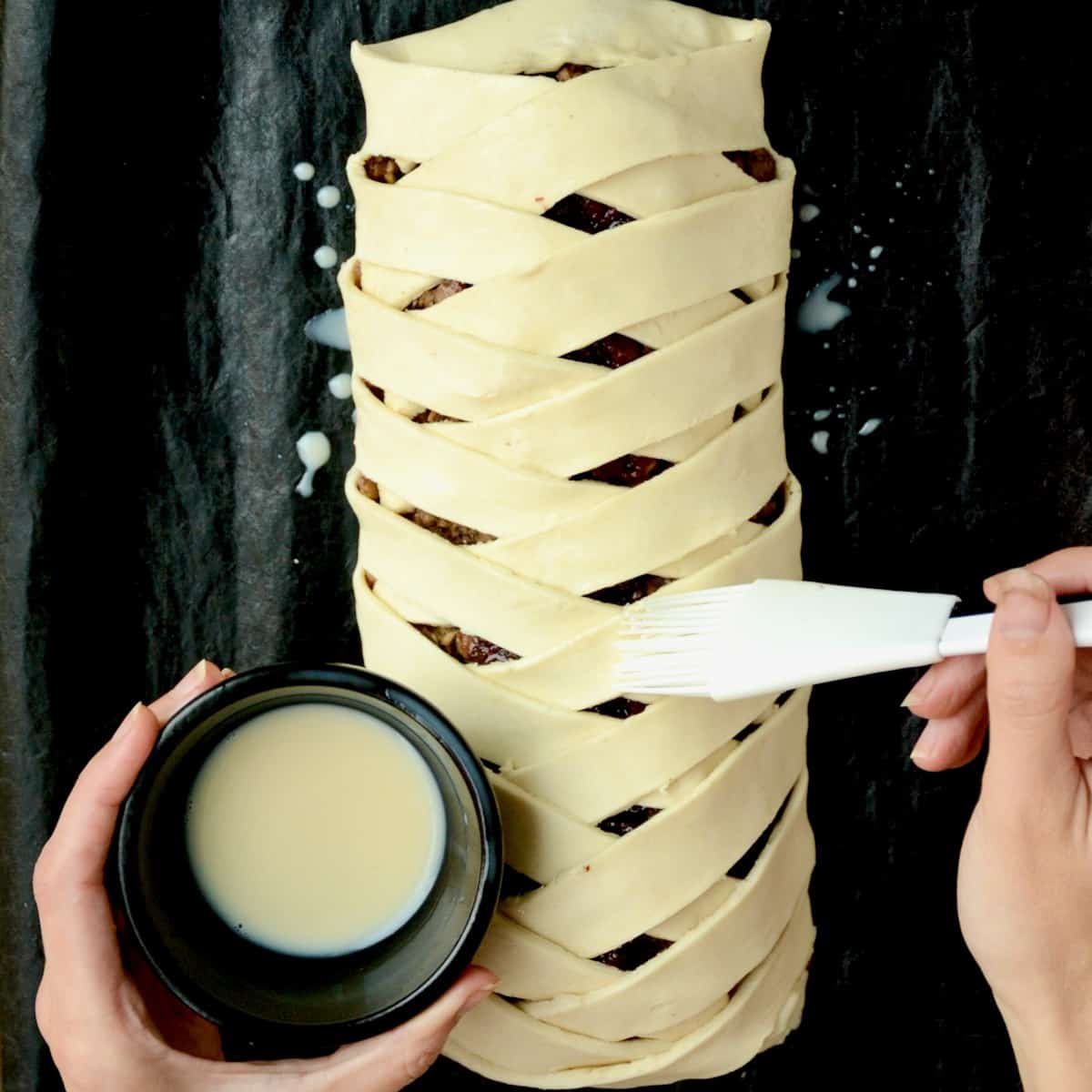 The puff pastry surface of the log is brushed with a combination of soy milk and maple syrup.