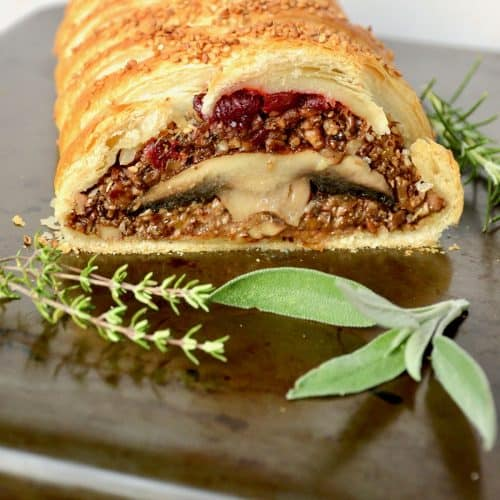 A wellington with mushroom filling. The puff pastry, the cooked filling and whole mushrooms offer a lot of different textures in this dish.