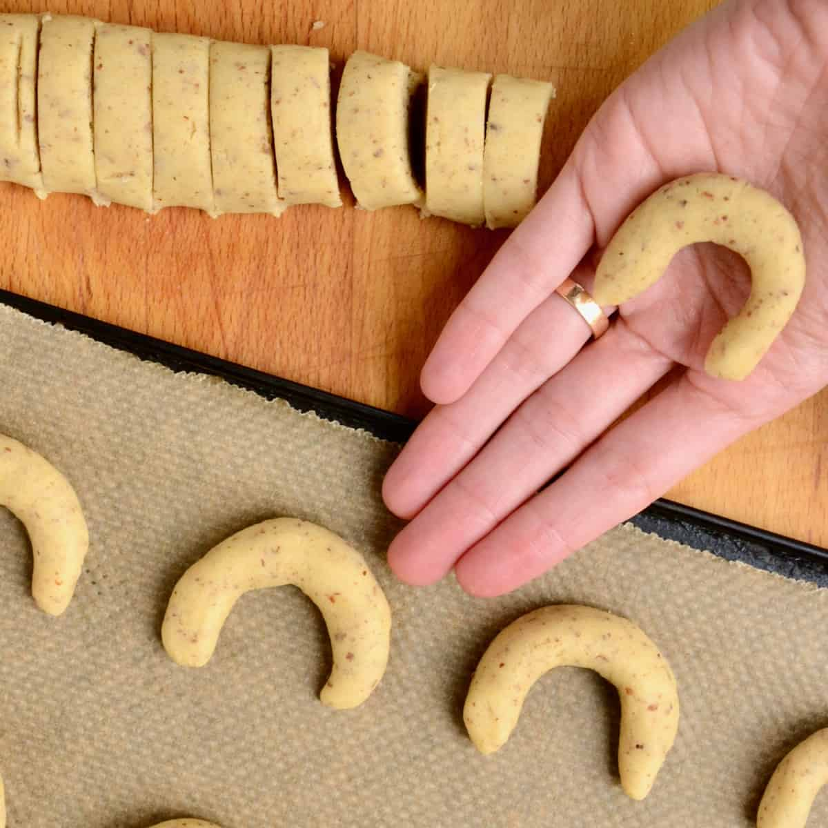 The small pieces of dough are rolled by hand into finger-long ropes and then shaped into a u-shaped crescent.