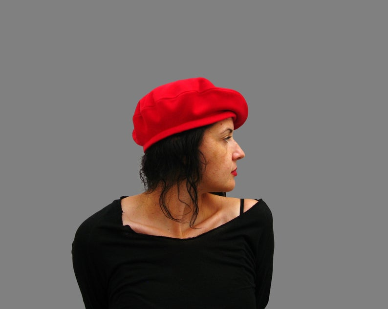 A model wearing a red beret.