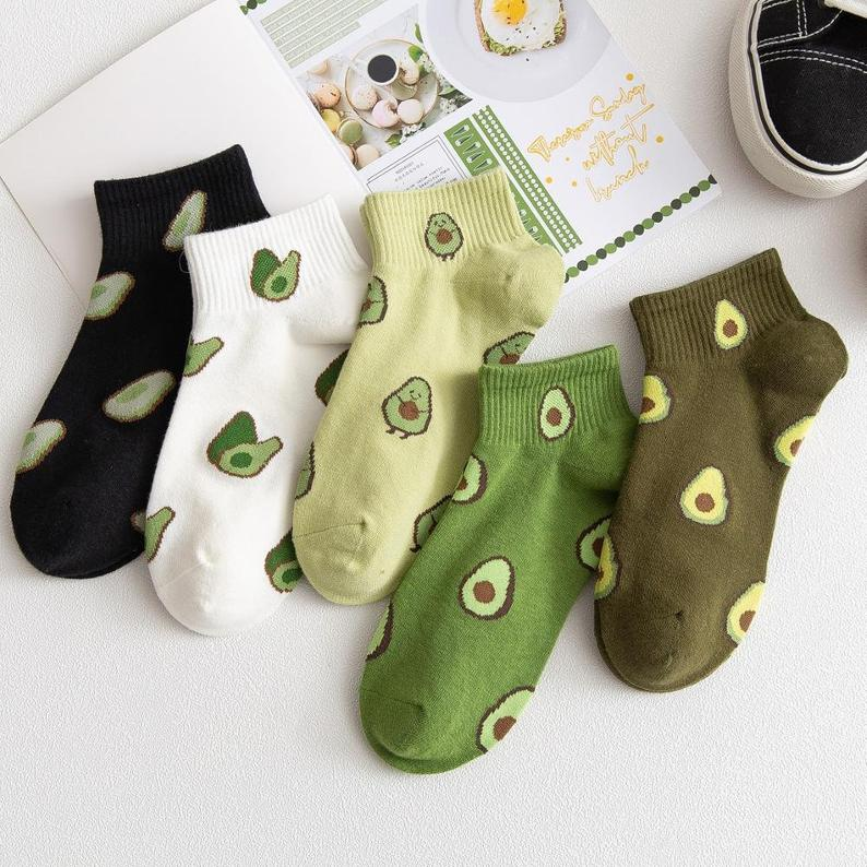 Socks in various colours with avocado prints.