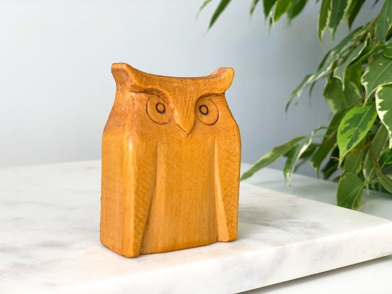 A wooden sculpture of an owl.