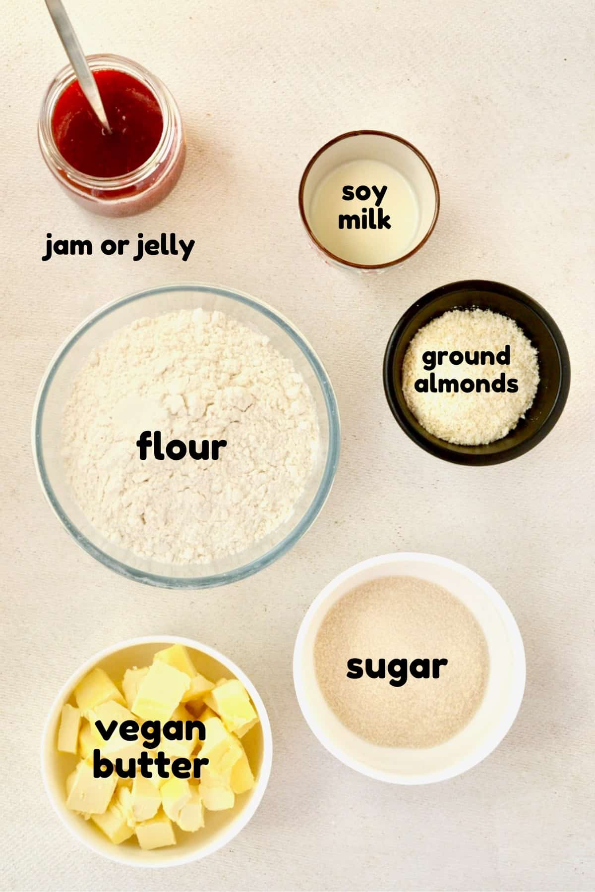 The ingredients for the cookies: Flour, sugar, vegan butter, ground almonds, soy milk, jam. Not in the picture: Icing sugar for dusting.