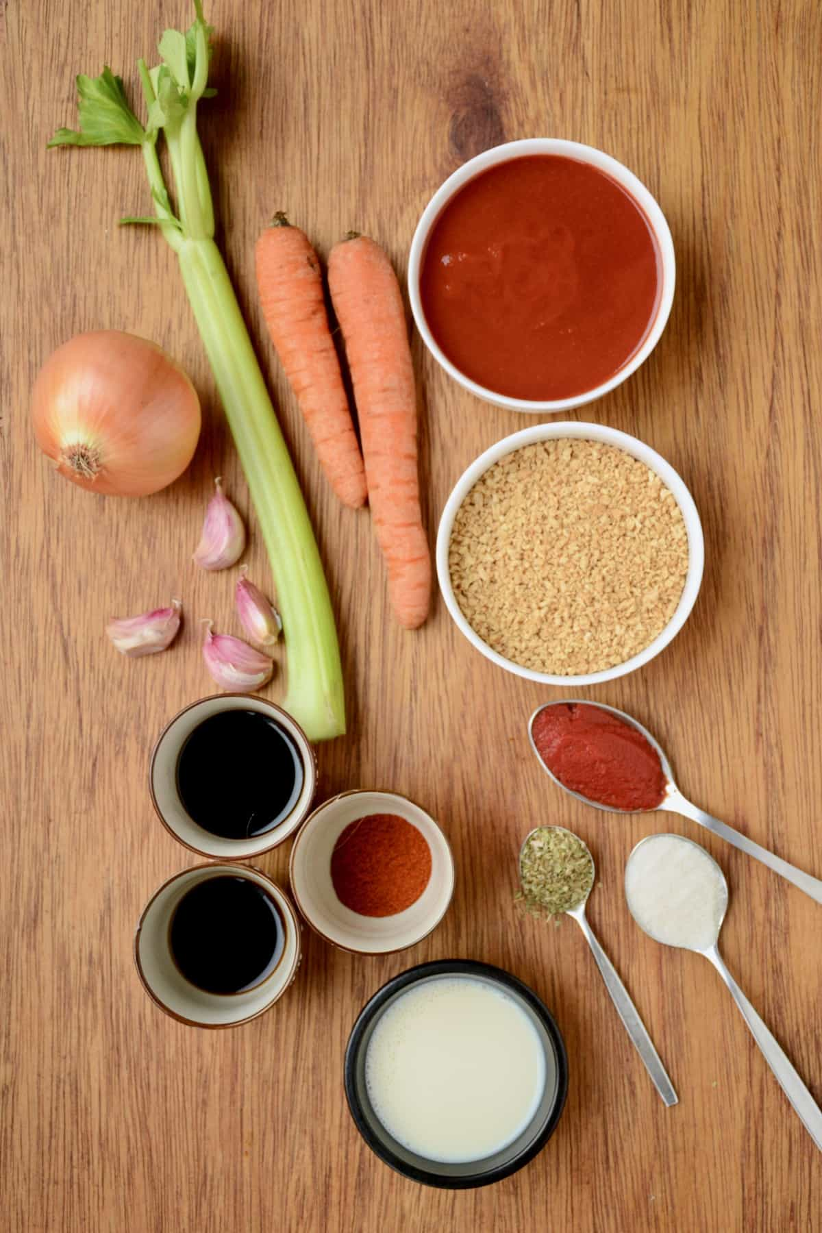 The ingredients for the vegan bolognese sauce laid out on a table.