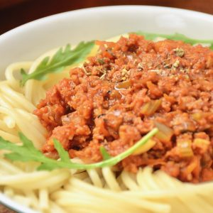 A close up of a bowl of spaghetti bolognese.