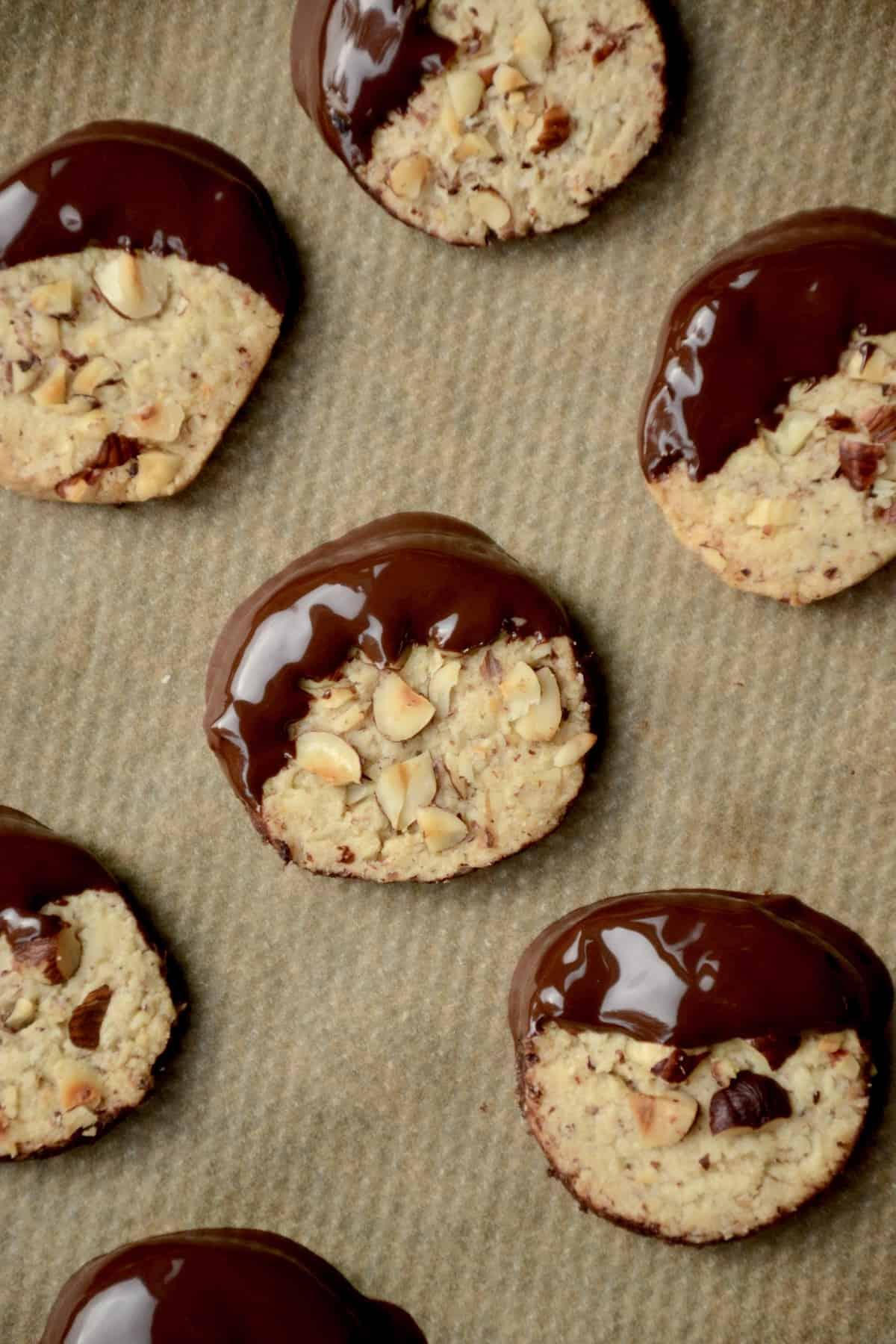 Cookies half dipped in dark chocolate.