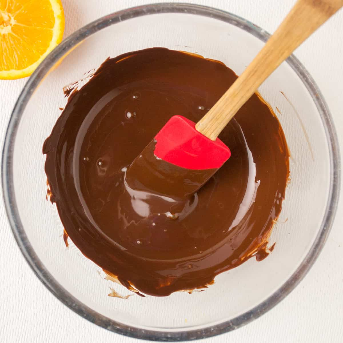 A glass bowl of melted chocolate.