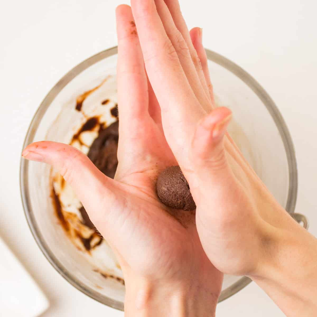 Rolling a ball of the chocolate truffle mix between the palms of two hands.