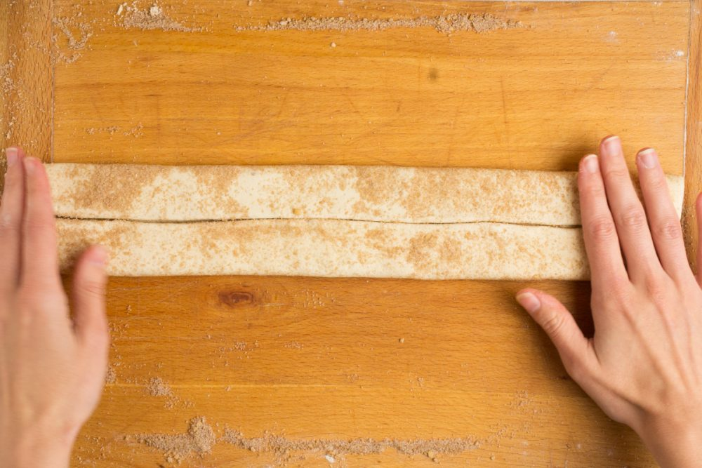 The dough has now been folded twice into the centre to form a long strip.
