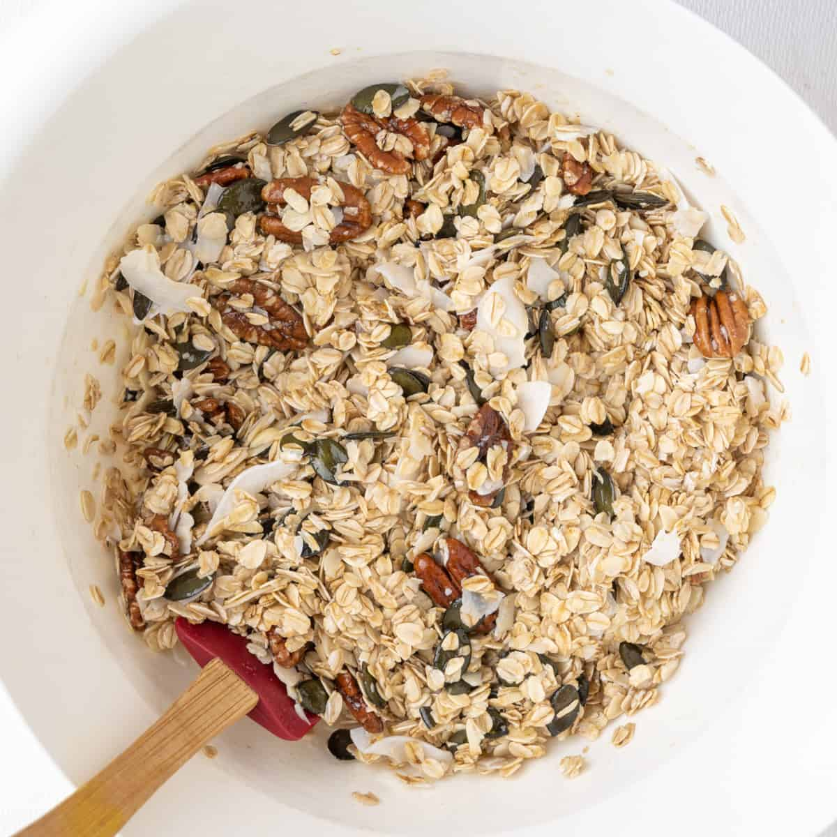 A large mixing bowl in which the granola ingredients get combined.