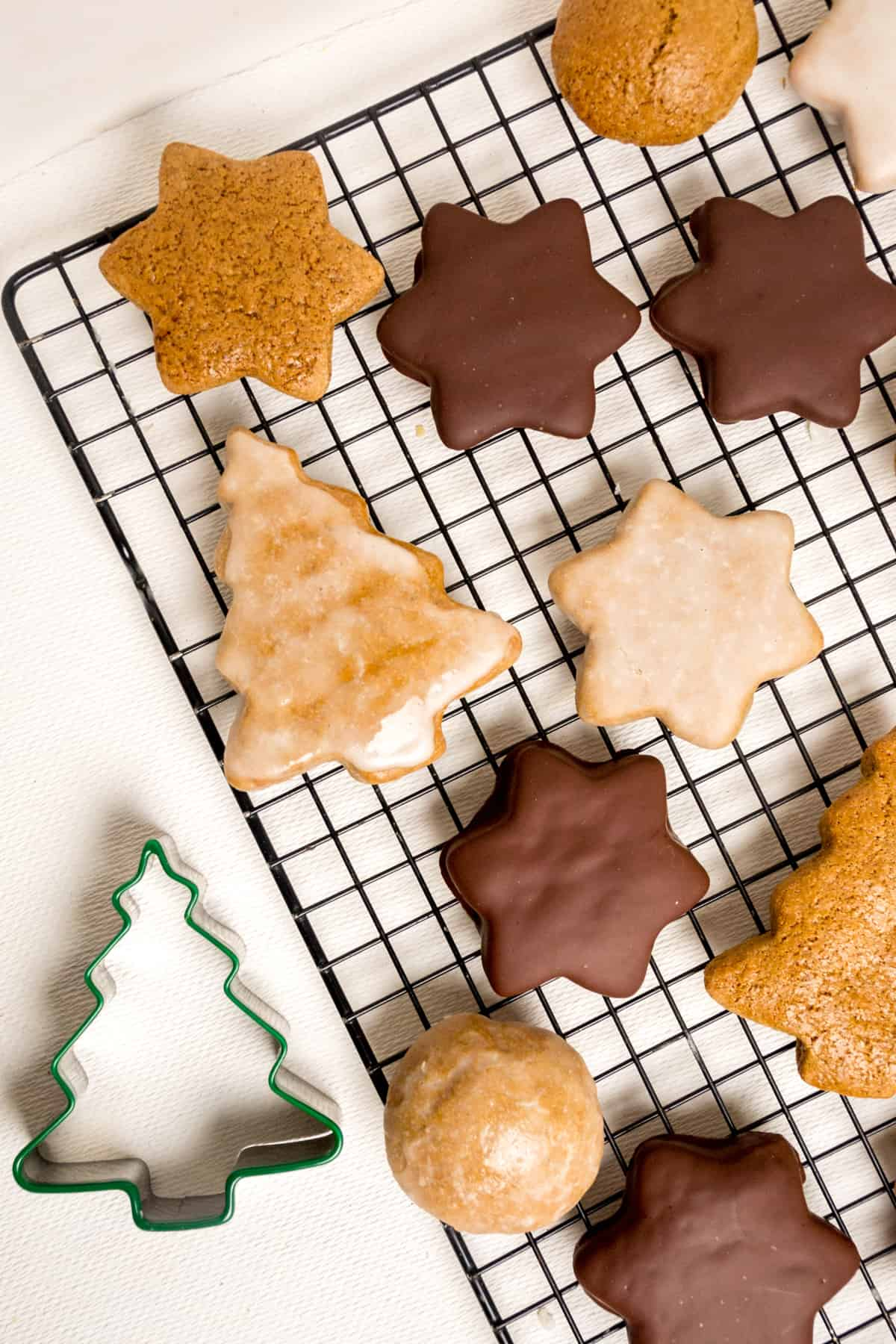 Christmas shaped cookies on a wire cooling rack.