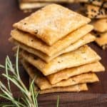 A stack of homemade square vegan crackers.