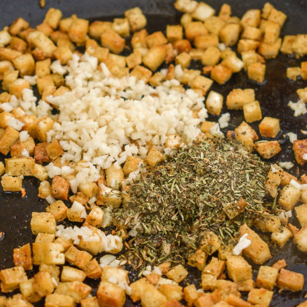 Dried herbs and garlic are added to the tofu.