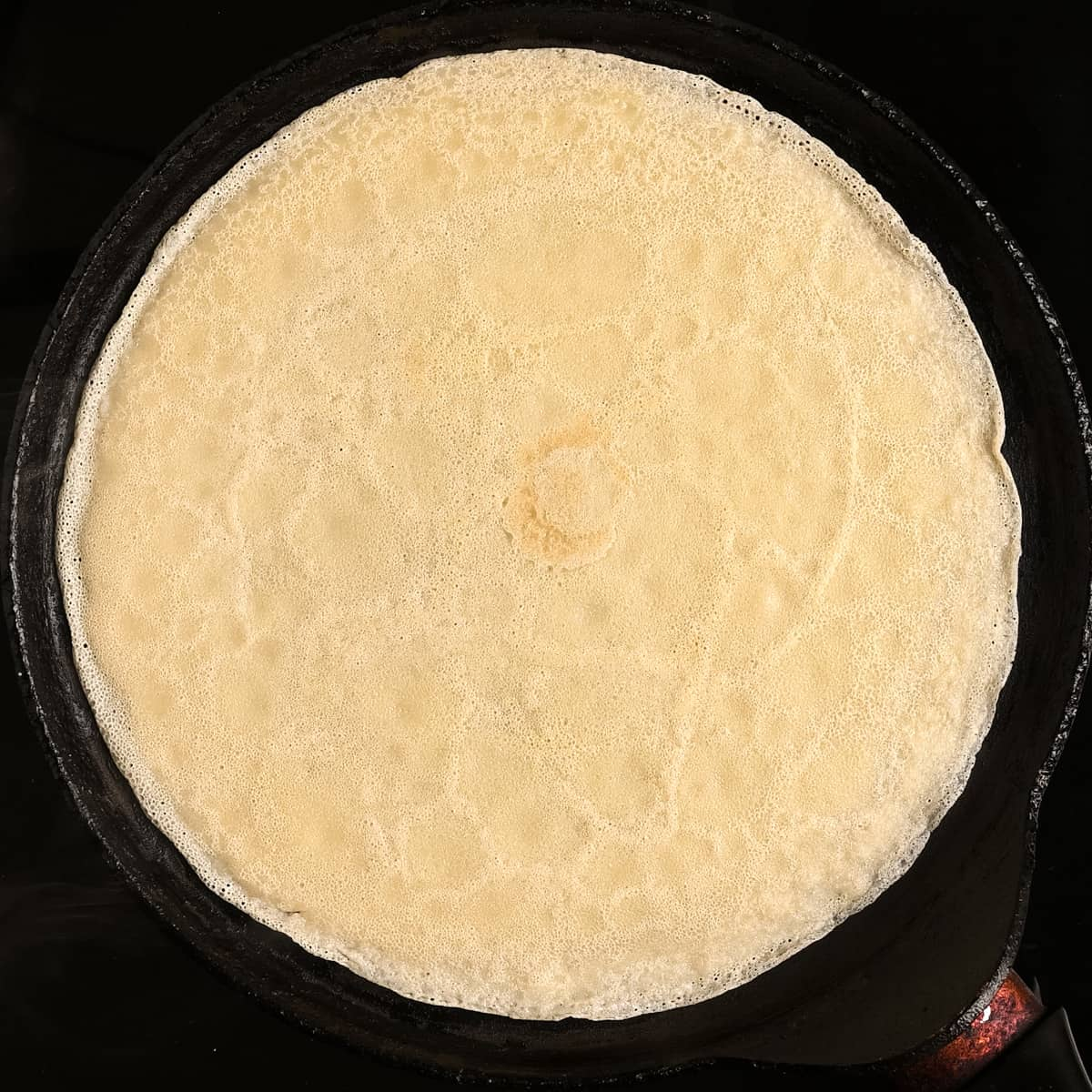 A cooked crepe on a pan.