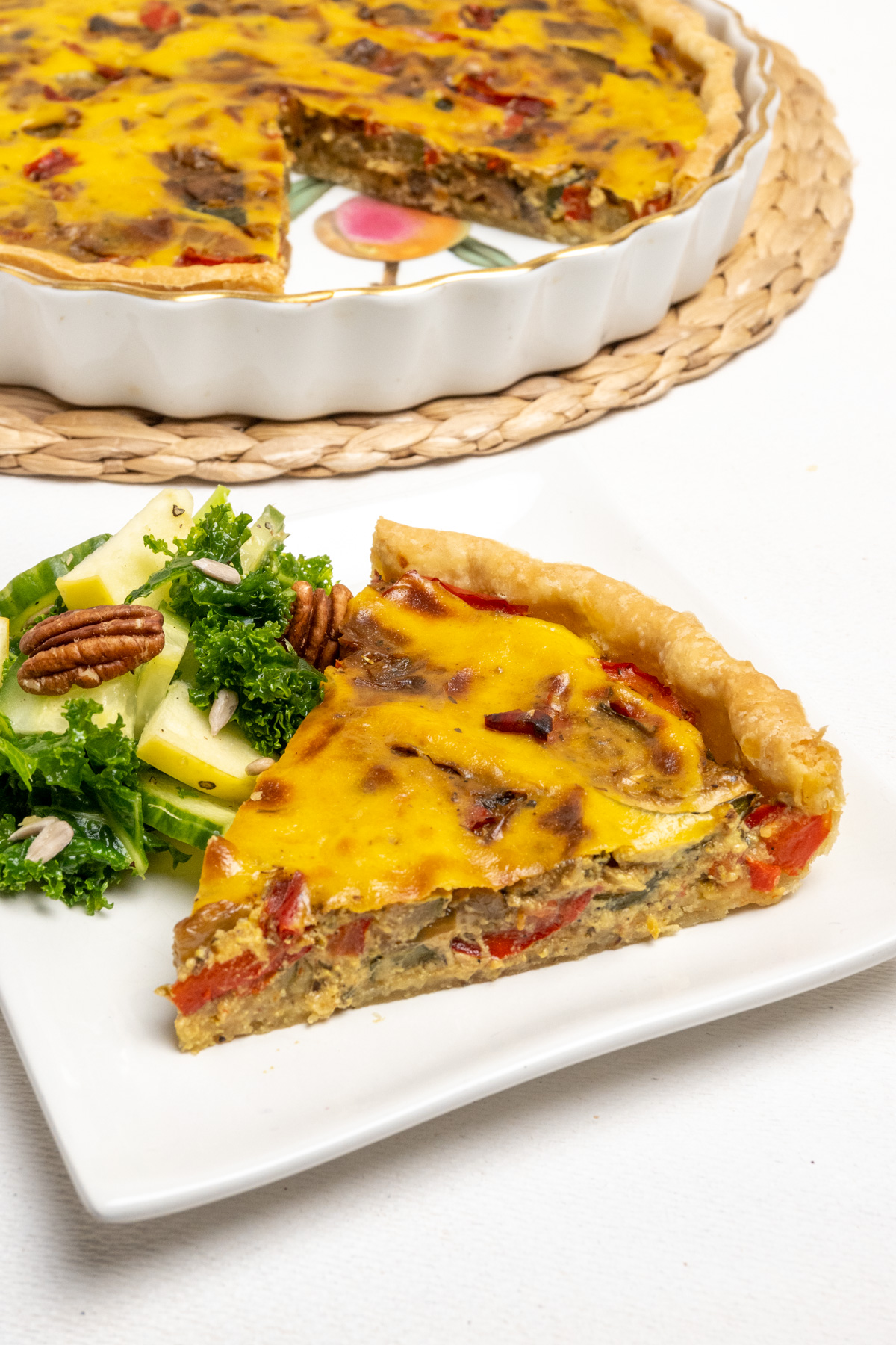 A slice of vegan quiche ready to eat.