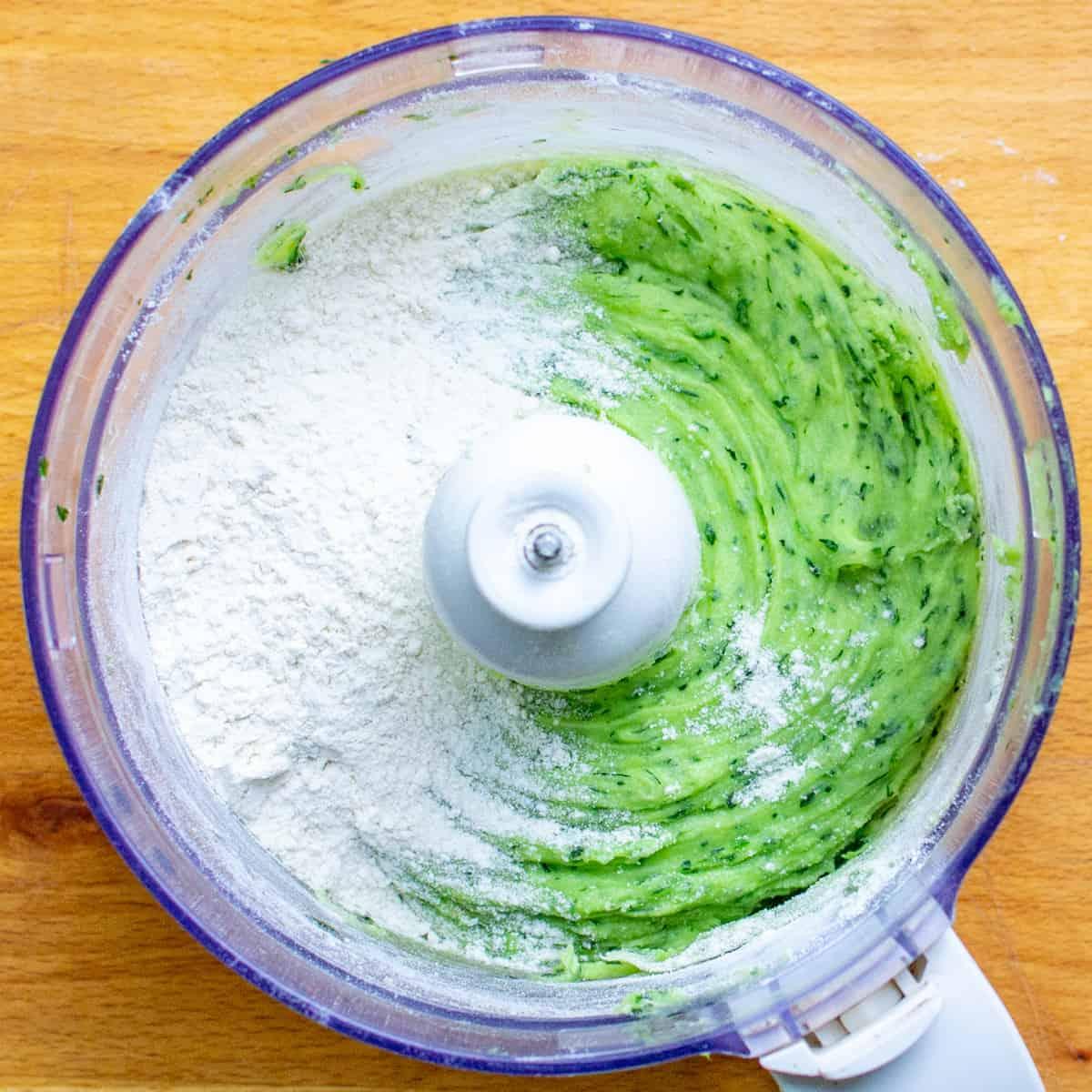 Adding the flour to make the gnocchi dough.