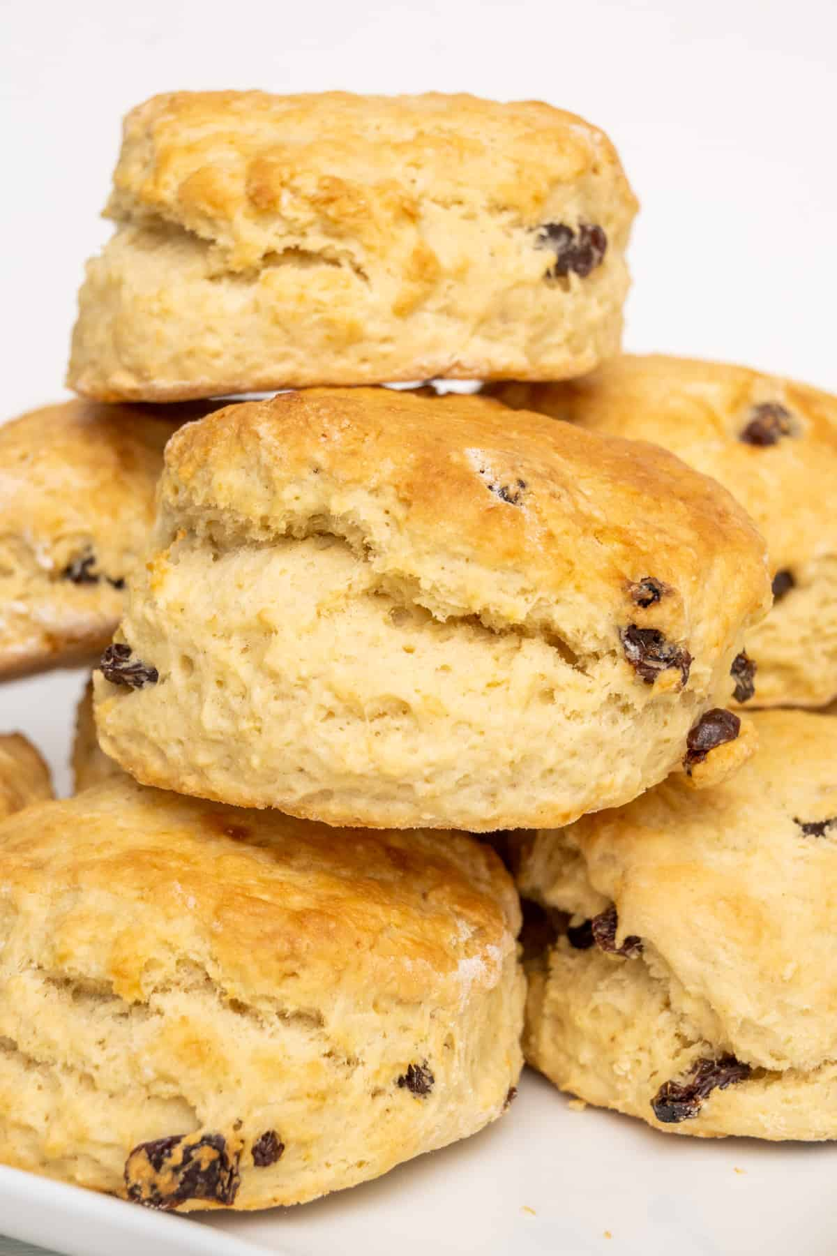 Scones stacked on a plate.