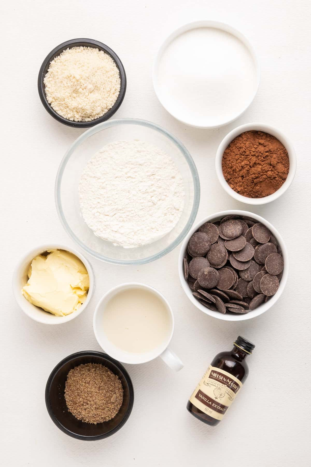 The ingredients for a vegan chocolate brownie on a white background.
