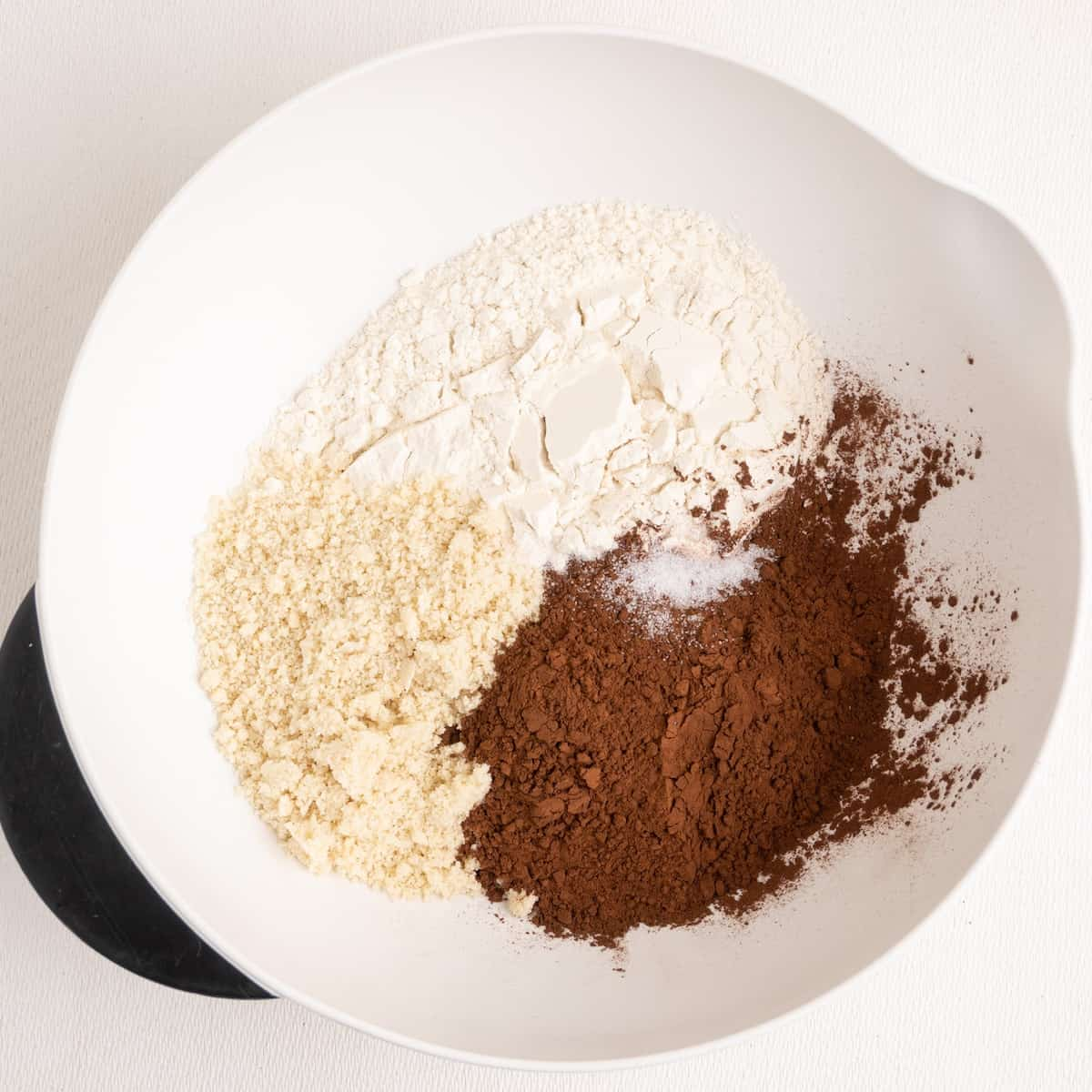 Flour, slat, ground almonds and cocoa powder in a mixing bowl.