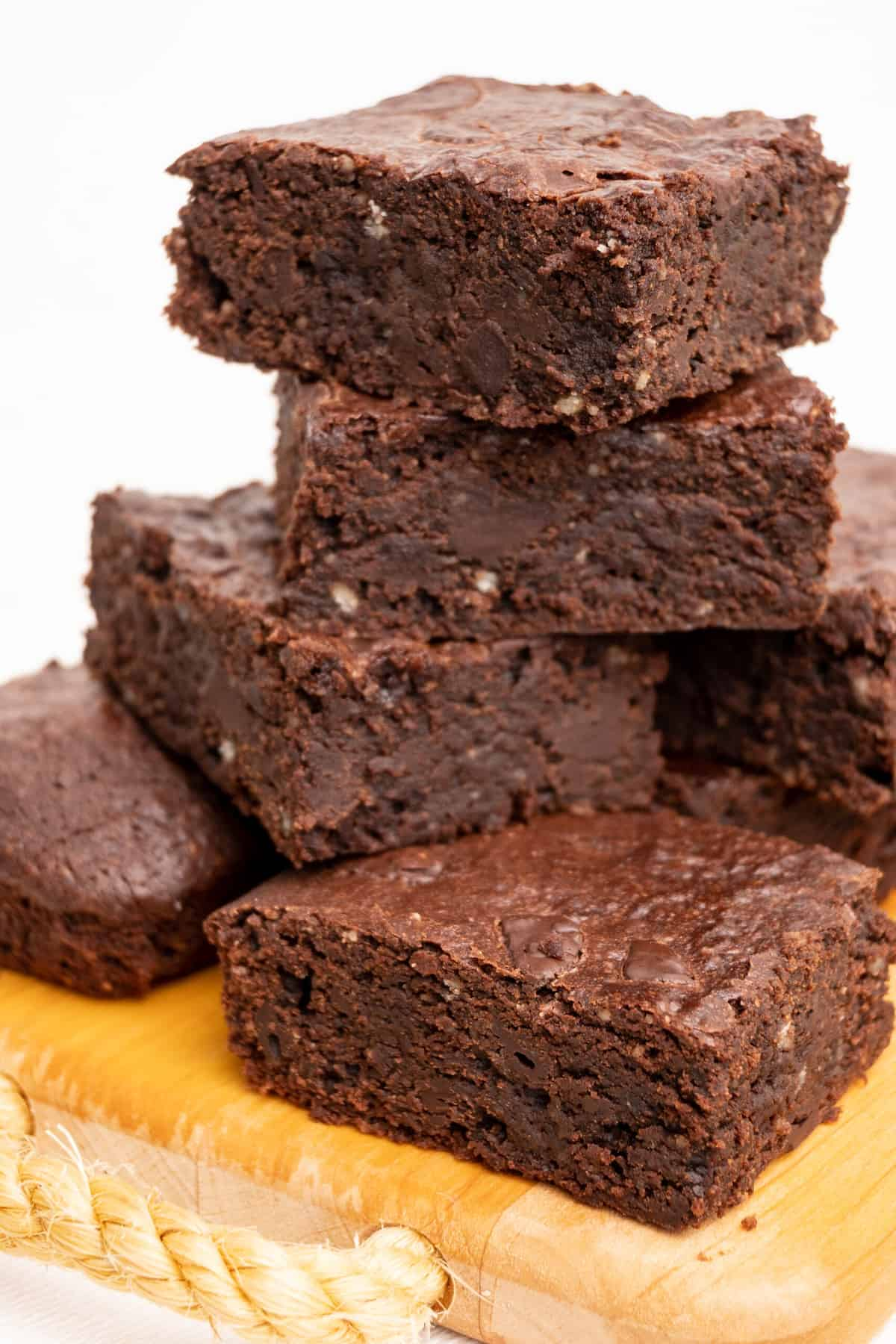 A stack of homemade vegan brownies ready to be eaten.