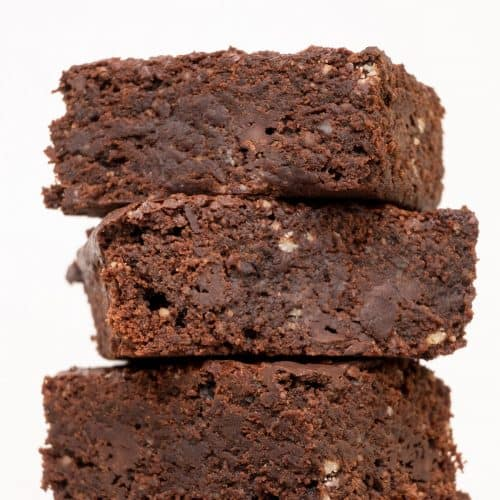 A stack of vegan chocolate brownies seen from the side.