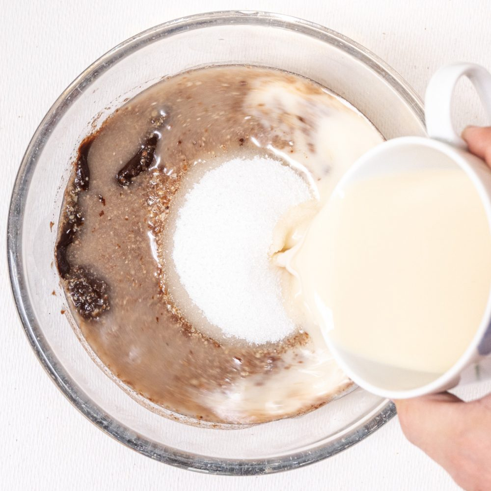 Melted chocolate is combined with sugar, flax egg, vanilla extract and oat milk.
