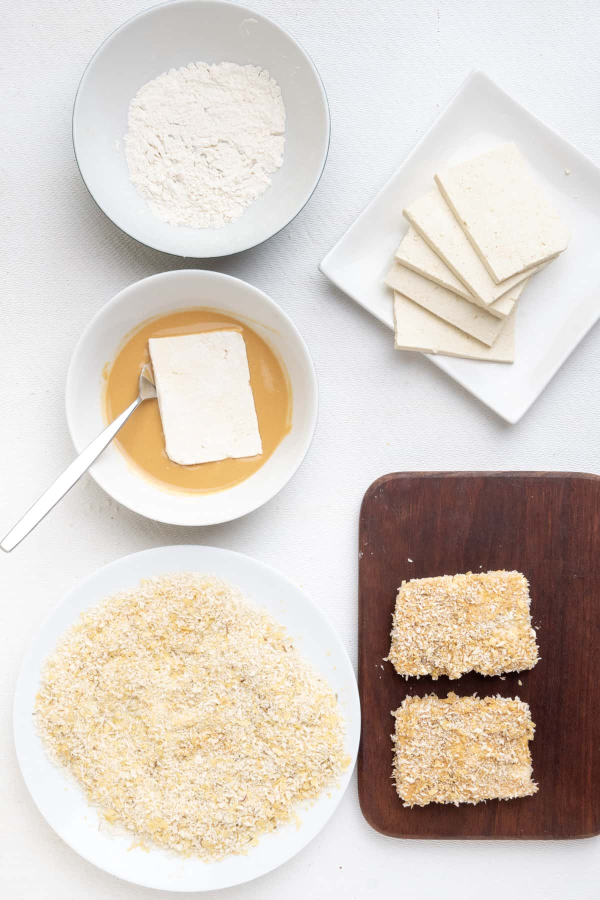 Illustrating the three coatings of the breading: White flour, batter and the seasoned breadcrumbs.