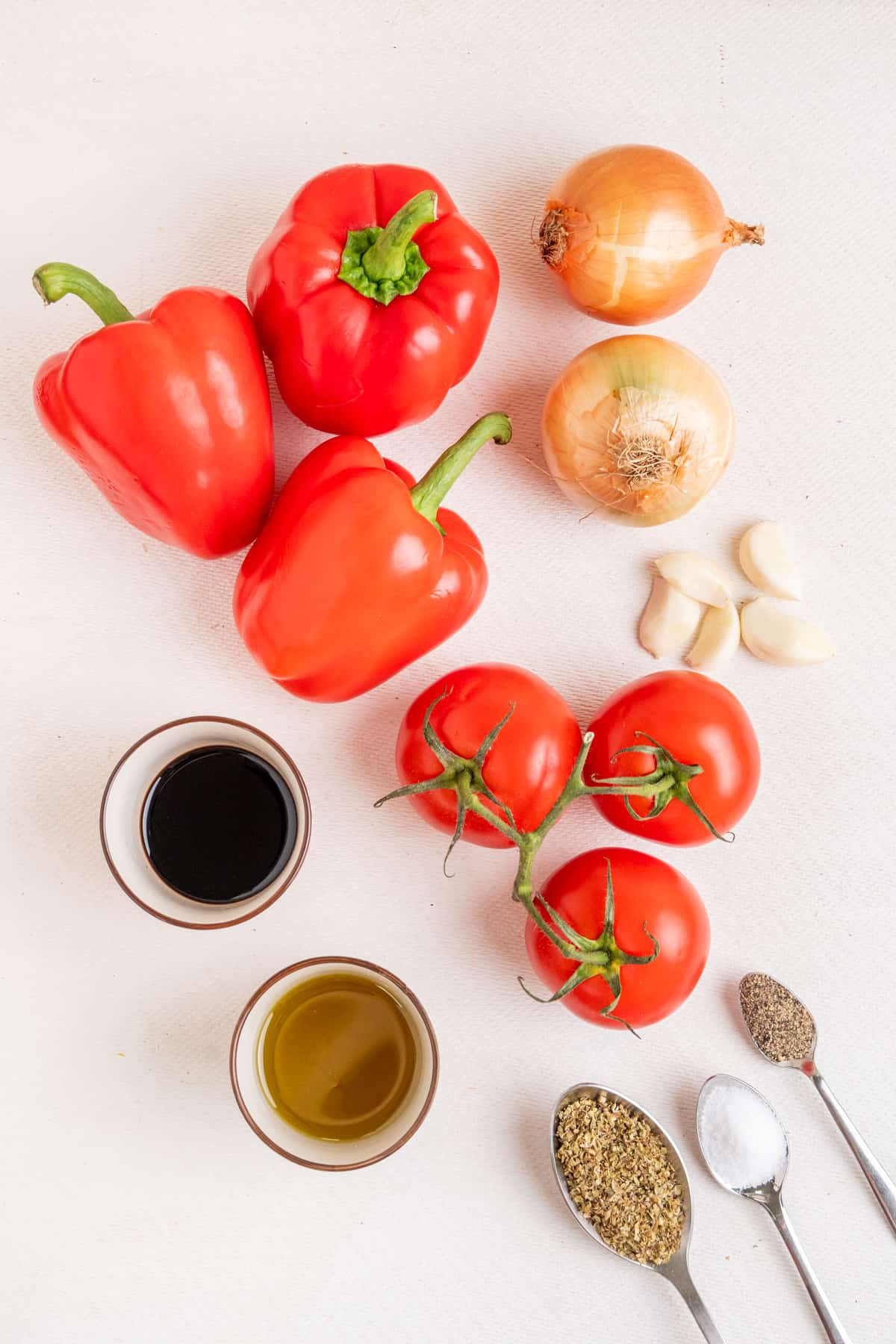 The ingredients for the red pepper and tomato sauce: Red sweet peppers, fresh tomatoes, onions, garlic, olive oil, balsamic vinegar, dried oregano, salt and ground black pepper.