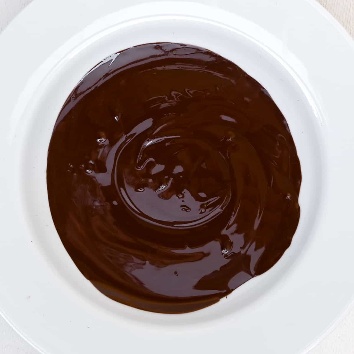 Melted dark chocolate in a bowl.